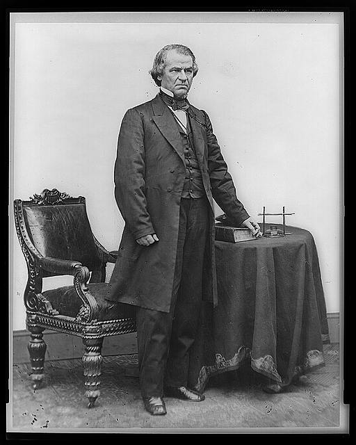 Andrew Johnson, full-length portrait, standing, facing right, with table and chair, Library of Congress