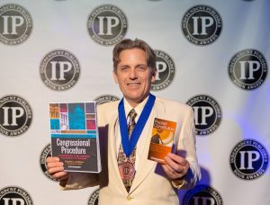 Steve O'Keefe of Orobora accepting the IPPY Award on behalf of TheCapitol.Net for Congressional Procedure in New York, May 28, 2019